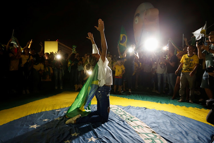 EVANGELICAL ZEAL: Supporters of Jair Bolsonaro celebrate his victory in Brazil's presidential race, in Brasilia, on October 28 2018. Picture: REUTERS/ADRIANO MACHADO