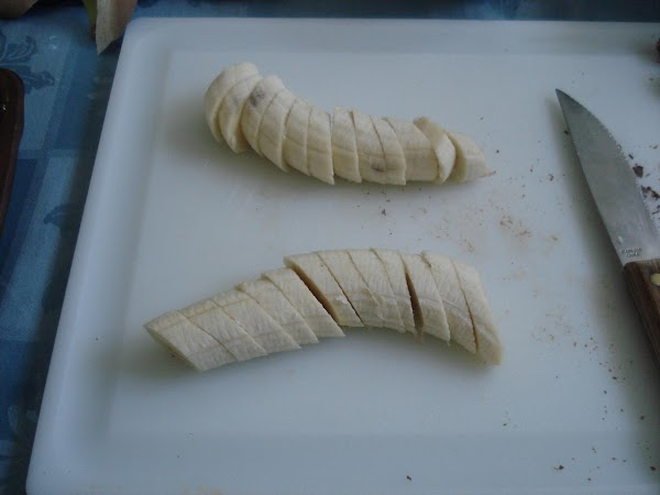 Using Knife, slice bananas diagonally into twenty-four 1/4-inch-  thick (6-mm) slices.