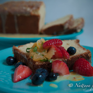 Orange yogurt pound cake with orange citrus-glazed with Spring fruit salad compote.