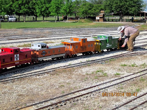 Photo: Rick White uncoupling the D&RG Ballast Car from CABOOSE ROW.    HALS Public Run Day 2014-0419 DH3