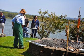 Photo: Don raking the salmon