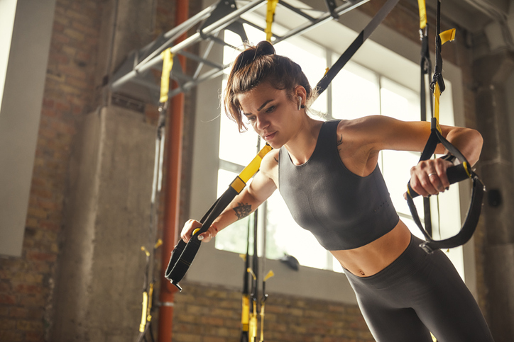 Woman doing Chest Press with TRX