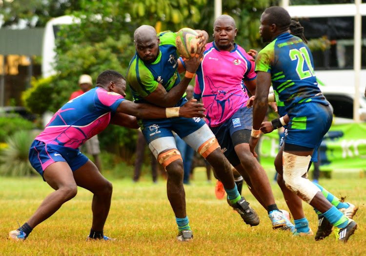 KCB's Nick Ongeri (R) takes on Bailey Anyasi of Western Bulls in a past Kenya Cup clash at Ruaraka