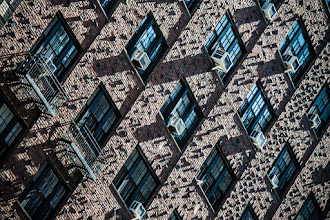 Photo: When I was in New York a few days ago I had the opportunity to walk up Central Park West in the morning. The sun was coming in at an angle which created some interesting shadows on some of the buildings. I don't remember exactly where this one was, but I liked the combination of the extended bricks combined with the air conditioning units to create an interesting texture.