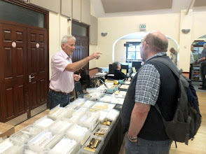 Photo: 003 Spotlight on the Traders 1 – Allen Doherty with his Worseley Works and soldering tutorial workshop has come all the way from Manchester to negotiate a price for some scrap brass offcuts with retired 009 Society Chairman David Gander .