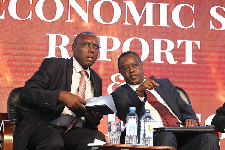 Kenya National Bureau Of Statistics Director General Zachary Mwangi with Planning PS Julius Muia during the launch of 2019 economic survey in Nairobi on Thursday, April 25,2019.