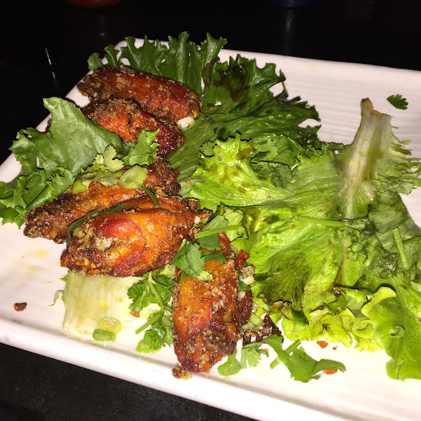 1/2 eaten plate of GFspicy wings appetizer