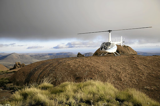 One of Fly Karoo's Robinson helicopters in the heart of the Great Karoo overlooking the Sneeuberg.