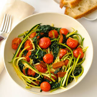 Zoodles with Vegan Bacon, Cherry Tomatoes & Kale.