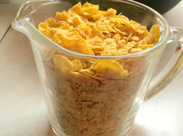 Melt the remainder 1/4 cup butter with your crushed corn flakes and sprinkle over...