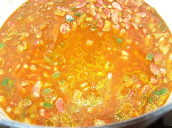 Add the soaked beans and ginger ale to the pot.