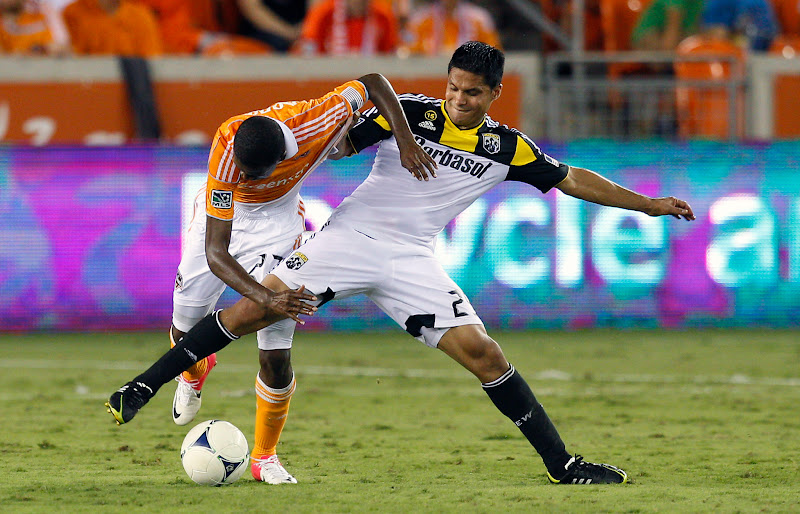 Photo: HOUSTON, TX - AUGUST 19:  Boniek Garcia #27 of the Houston Dynamo and Jairo Arrieta #25 of Columbus Crew fight for possession of the ball at BBVA Compass Stadium on August 19, 2012 in Houston, Texas.  (Photo by Bob Levey/Getty Images)