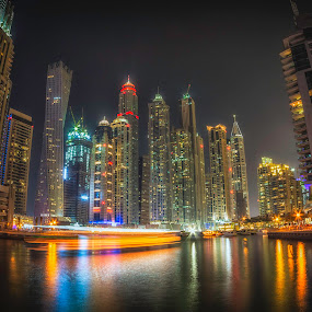 Dubai Marina by Rashid Ramdan - City,  Street & Park  Skylines ( water, canon, skyline, reflections, dubai marina, transportation, travel, photography, nightscape, dubai, uae, night, long exposure )