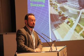 """Photo: """"Communicating Science & Innovations"""" Panel - 2012: Evgeny Kuznetsov speaking"""