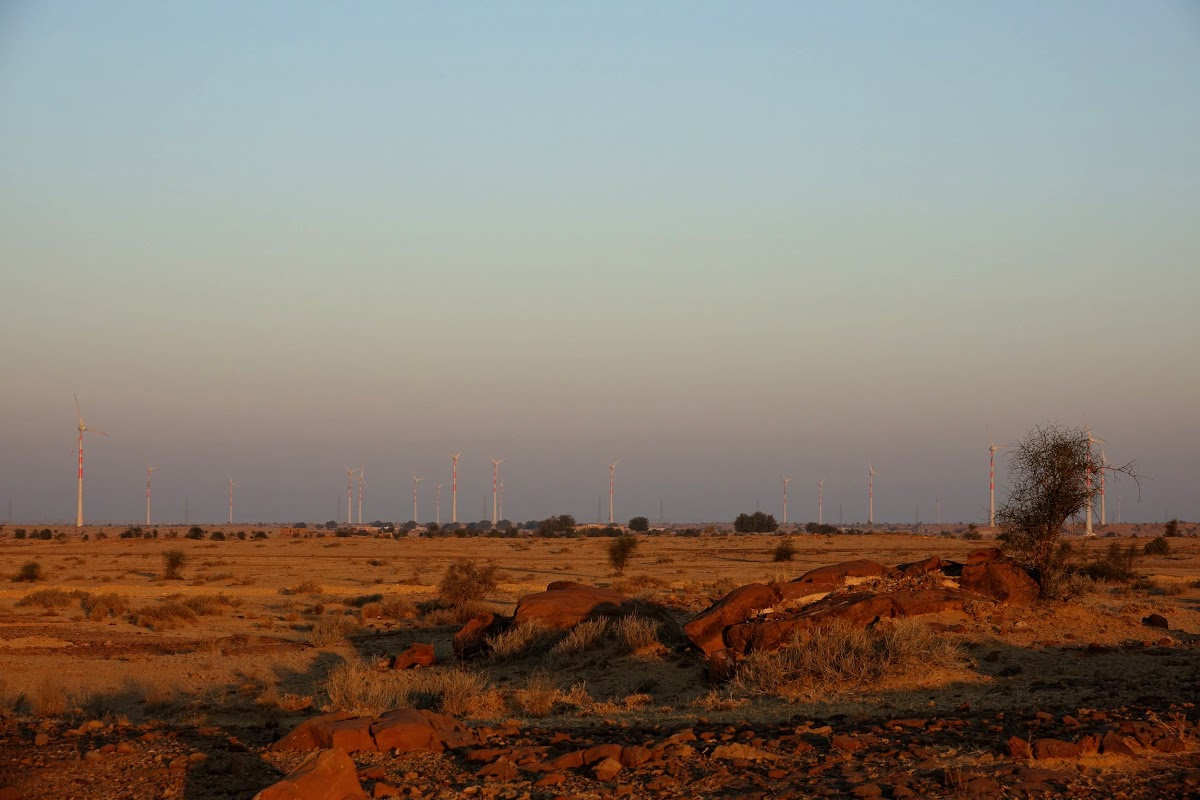 India, Rajasthan. Rising sun over the Thar desert windmills