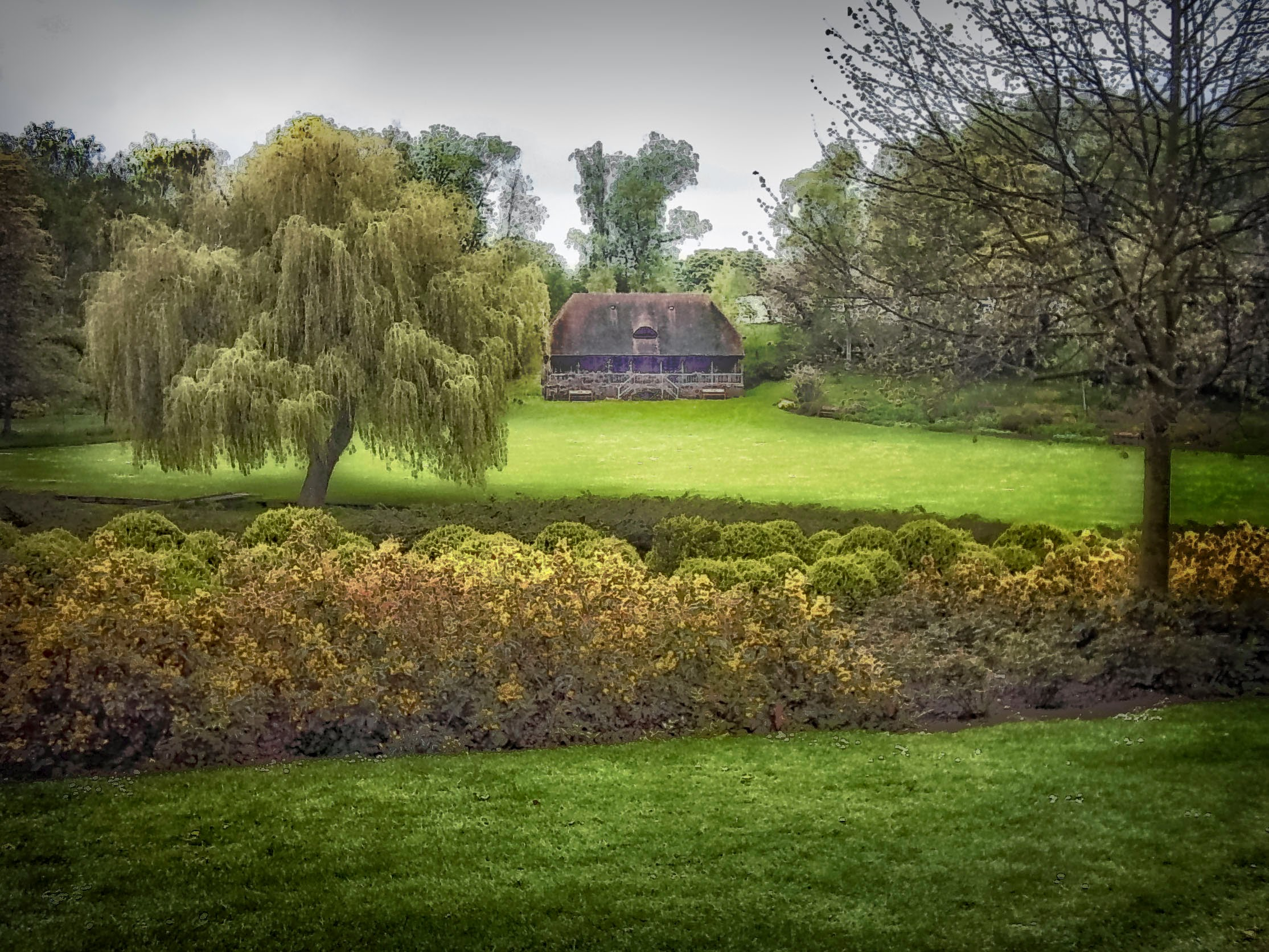 Photo: Thatch roof cottage on the grounds of Leeds Castle.