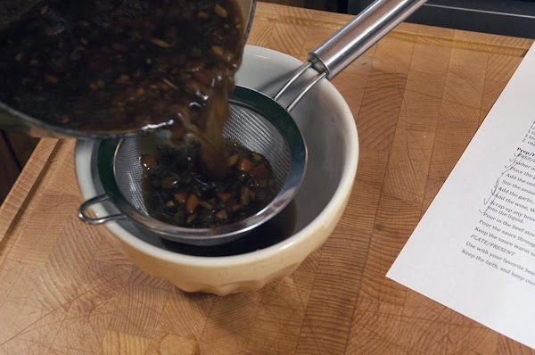 Pour the sauce through a fine mesh strainer, and discard the solids.