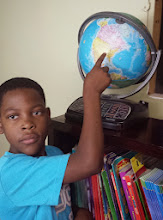 Photo: we find a globe. Jay points to TN