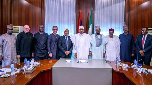 Last week, MTN CEO Rob Shuter (fourth from left) and MTN chairman Mcebisi Jonas (fifth) met Nigerian president Muhammadu Buhari (centre) when the telco announced investments in the West African country.