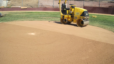 Photo: Rolling home plate area and basepaths now.
