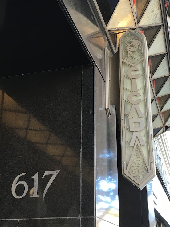 The art deco signage of The Cicada Restaurant.