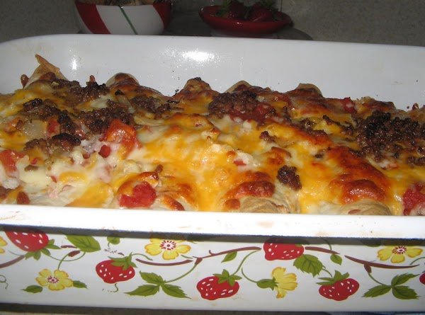 Sprinkle remaining cheese, tomatoes, and onion over top  tortillas in the baking pan....