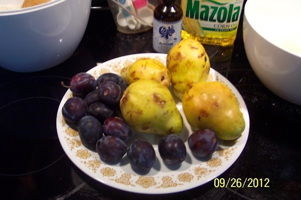 Gather your washed fruit. Heat oven to 325 F. grease and flour, 2 bread pans. Set aside.