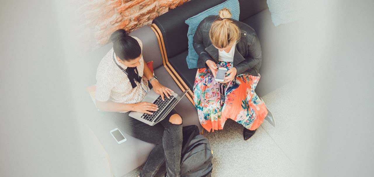 women on a laptop and mobile device