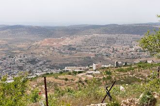 Photo: Nahalin (left) and Betar Illit, a Jewish settlement (right)