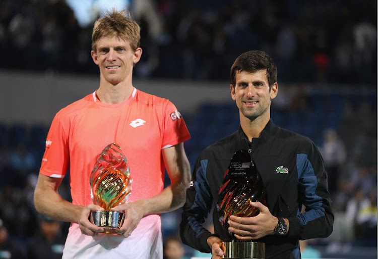 Serbian Novak Djokovic (right) after winning the Men's Singles finals alongside runner up Kevin Anderson of South Africa at the Mubadala World Tennis Championship at International Tennis Centre Zayed Sports City on Saturday.