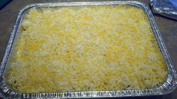 When noodles are done, drain well and fold into the cheese mixture.  Pour...