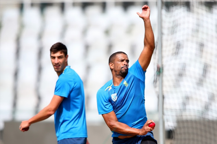 Vernon Philander sends down a delivery as Duanne Olivier looks on during South African national cricket team training session at PPC Newlands on January 01, 2019 in Cape Town, South Africa.
