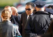 A file photo of late Boxing great Muhammad Ali being assisted as he enters the funeral for boxer Joe Frazier at the Enon Tabernacle Baptist church in Philadelphia, Pennsylvania, in November 2011.