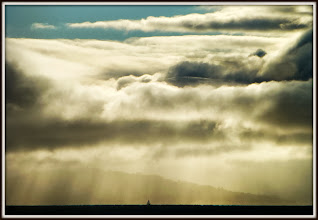 Photo: Lone sailor on S.F. Bay under heavy skies