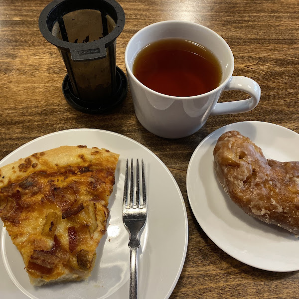 Slice of pizza and Apple Fritter with tea.