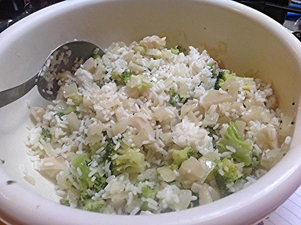 Add cooked rice to a medium size bowl, then add in microwaved onions and...