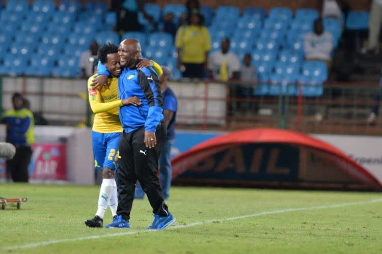 Percy Tau celebrates his goal with Mamelodi Sundowns coach Pitso Mosimane of Mamelodi Sundowns during the Absa Premiership match between Mamelodi Sundowns and Maritzburg United at Loftus Versfeld on December 13, 2017 in Pretoria, South Africa.