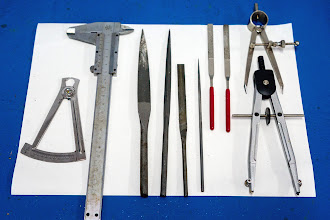 Photo: thickness gauges, metal working files, and compasses