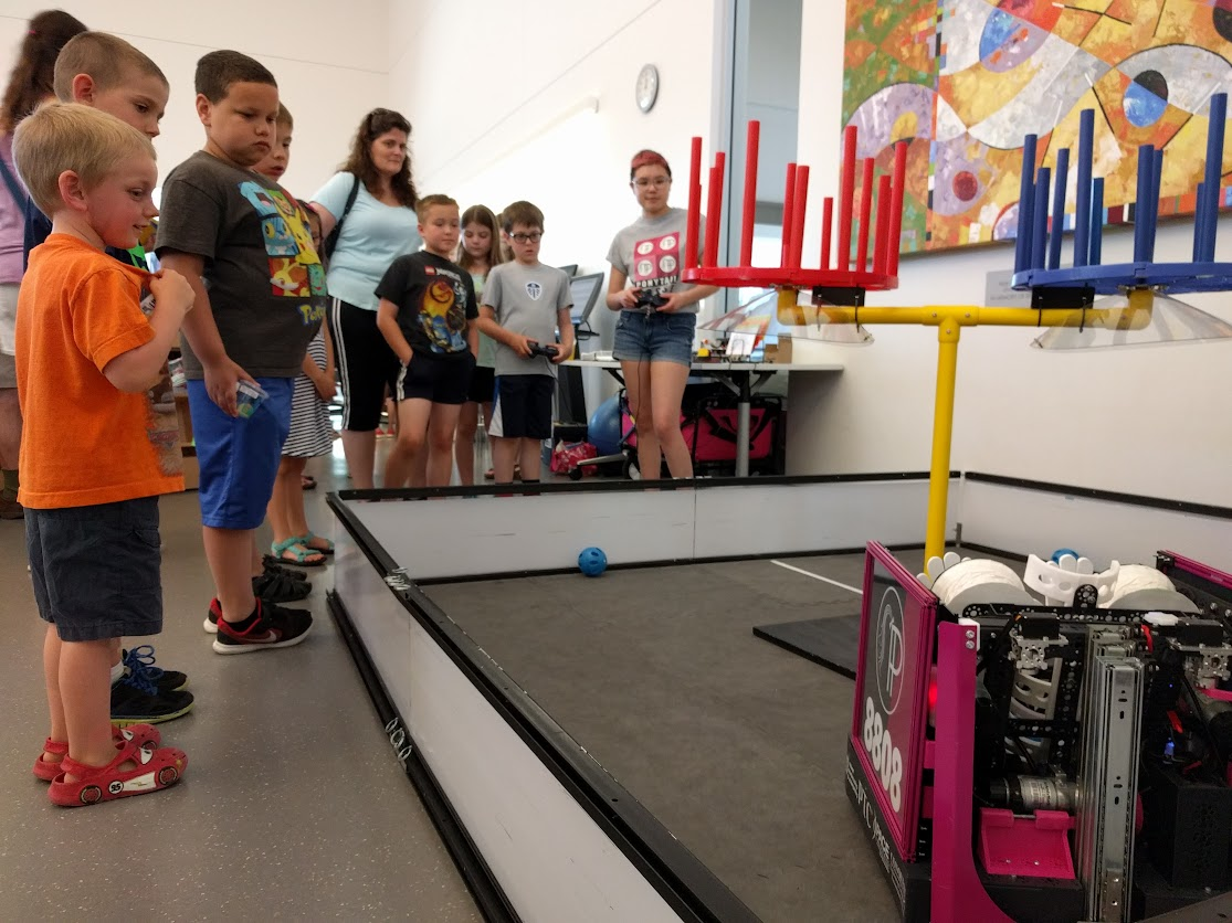 Kids in line to drive the robot
