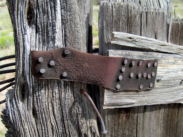 Leather strap used for a gate hinge