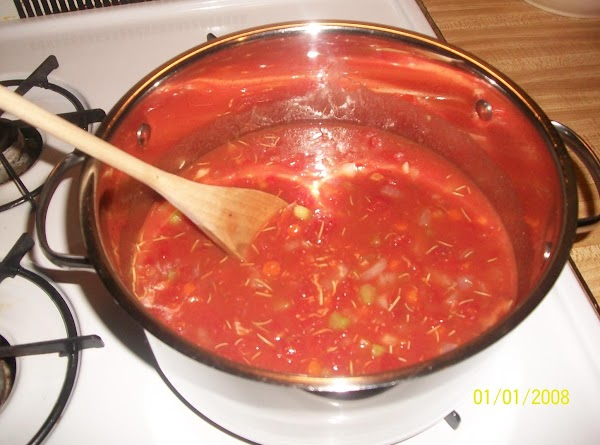 Stir in undrained tomatoes, tomato sauce, clam juice, rosemary and pepper.  Bring to...