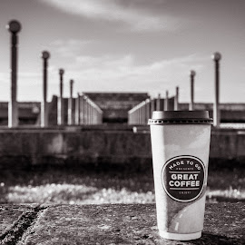 coffee cup by Maksim Kozlov - Buildings & Architecture Other Exteriors ( cup, tea time, shop, nobody, reading, old, cafeteria, indoor, relax, colorful, bw, plank, ceramic, spoon, object, blur, beauty, tea, chinese, coffee shop, magazine, lantern, style, seat, drink, light, china, building, vintage, decoration, table, chair, blurred, food court, wooden, pattern, beverage, background, book, coffee cup, night, light bulb, wooden table, design )