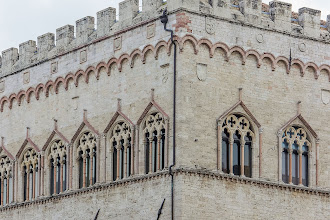 Photo: The beautifully embellished windows of the Palazzo dei Priori