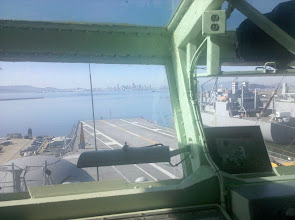 Photo: looking out on the flight deck from the operations room