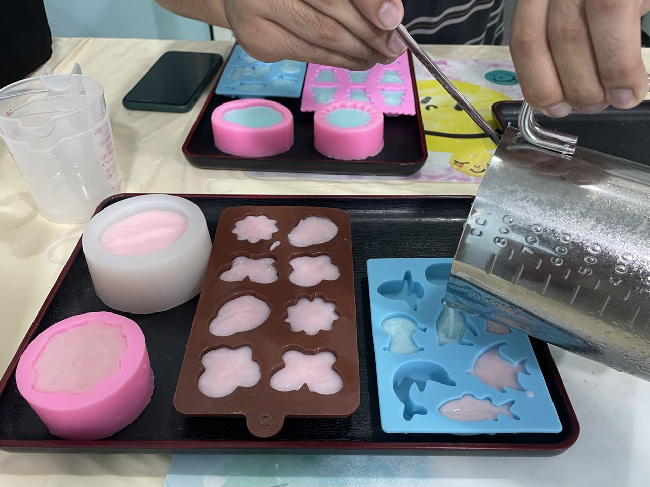 pouring the soaps into the mould