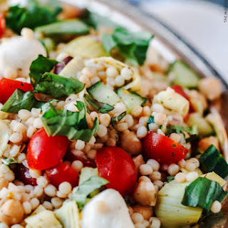 Israeli Couscous Recipe with Chopped Vegetables, Chickpeas, and Artichokes.