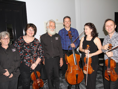 Friends of The Crossing Theatre committee member Alison Young, Goldner Quartet violinist Irina Morozova, Friends president Colin Tann, and Quartet members Julian Smiles, Dimity Hall and Dene Olding.