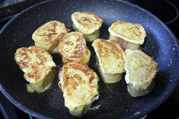Melt the butter in a large saute pan. Add the baguette slices to the...