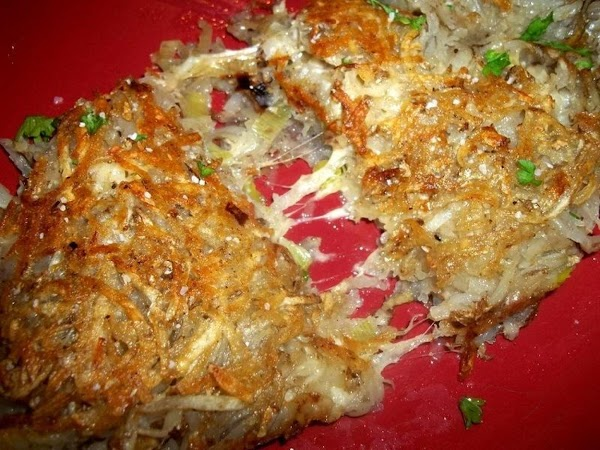 Take a large enough plate, bigger than skillet and place over skillet and flip...