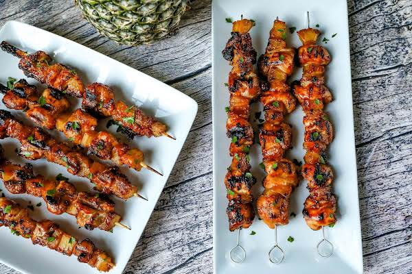 Two Platters Of Chicken Pineapple Kabobs.